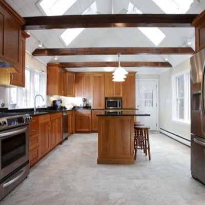 Well-lit kitchen with beams