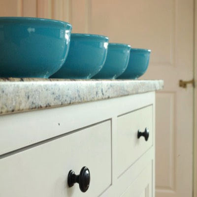 Four blue bowls on counter